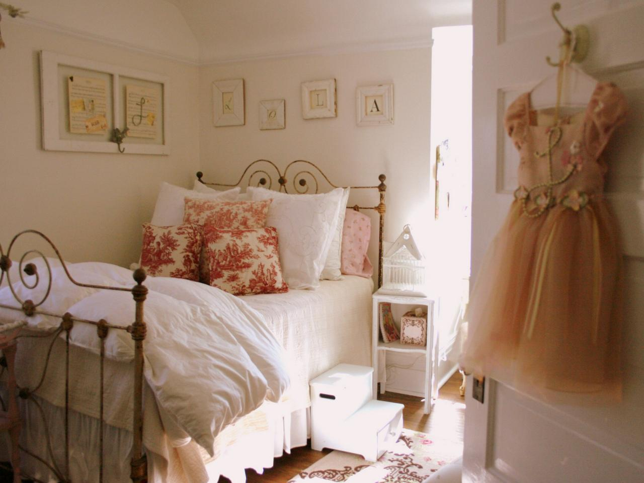 romantic-valentines-themed-small-girly-bedroom-decorating-ideas-with-comfortable-full-size-wroughtiron-bedstead-include-pure-white-bedding-sheet-plus-pink-flower-patterned-soft-foam-pillows-moreover-b